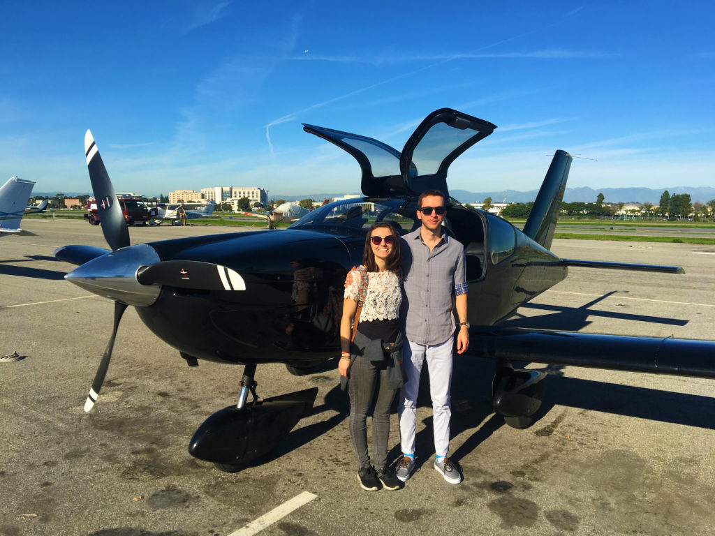 alex and ethan in front of the black socata tobago tb-10 at zamperini field in torrance - happy!