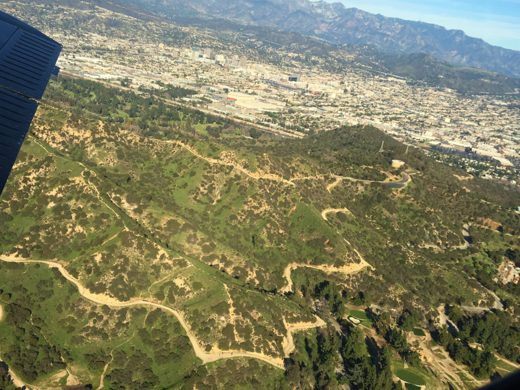 flying over mountain trails and roads