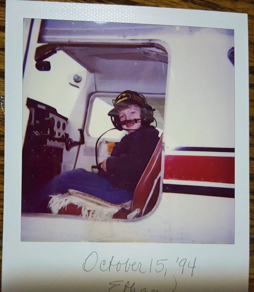 polaroid of mini-batman-ethan in a plane: october 15 1994